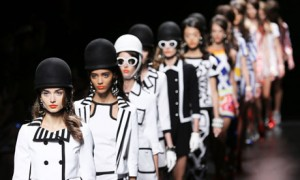 Models wear creations from Moschino women's spring-summer 2013 collection, during Milan fashion week